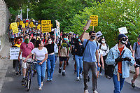 Washington, DC - June 15, 2020: Protesters march towards Interstate 395/695 in Washington, DC June 15, 2020 to call for police justice and reform in the wake of the police killing of George Floyd in Minnesota.  (Photo by Don Baxter/Media Images International)