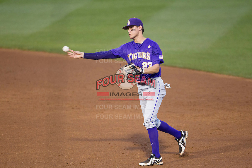 LSU Tigers second baseman Jacoby Jones (23) makes a throw to first base against the Texas A&M Aggies in the NCAA Southeastern Conference baseball game on May 10, 2013 at Blue Bell Park in College Station, Texas. LSU defeated Texas A&M 7-4. (Andrew Woolley/Four Seam Images).