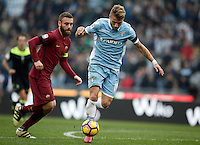 Calcio, Serie A: Lazio vs Roma. Roma, stadio Olimpico, 4 dicembre 2016.<br /> Lazio's Ciro Immobile, right, is chased by Roma's Daniele De Rossi during the Italian Serie A football match between Lazio and Rome at Rome's Olympic stadium, 4 December 2016. Roma won 2-0.<br /> UPDATE IMAGES PRESS/Isabella Bonotto