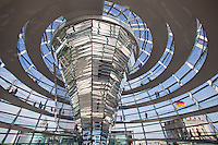 Dome of the restored German Reichstag (Parliament). Designed by British architect Norman Foster, the dome incorporates energy saving green design on top of the famous historical building, using mirrors to reflect daylight down into the parliamentary chambers and a funnel to collect rainwater and remove stale air. Open to the public, the dome has become Berlin's number one tourist attraction since it was unveiled in 1999..