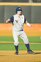 Taylor Munden (3) of the West Virginia Mountaineers takes his lead off of second base against the Wake Forest Demon Deacons at Wake Forest Baseball Park on February 24, 2013 in Winston-Salem, North Carolina.  The Demon Deacons defeated the Mountaineers 11-3.  (Brian Westerholt/Four Seam Images)