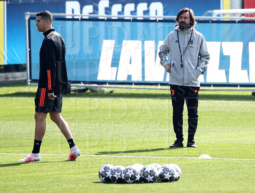 Juventus' Cristiano Ronaldo (L) attends a training session  while Juventus' coach Andrea Pirlo looks at the players on the eve of the UEFA Champions League football match Juventus vs FC Porto on March 8, 2021 at the Juventus training center in Turin.<br /> UPDATE IMAGES PRESS/Isabella Bonotto