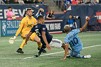 FOXBOROUGH, MA - SEPTEMBER 29: Brandon Bye #15 of New England Revolution slides to intercept a shot on goal during a game between New York City FC and New England Revolution at Gillettes Stadium on September 29, 2019 in Foxborough, Massachusetts.