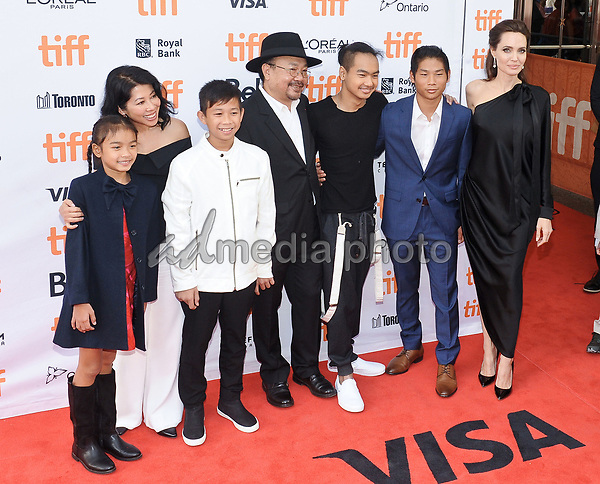 """11 September 2017 - Toronto, Ontario Canada - Sareum Srey Moch, Loung Ung, Kimhak Mun, Rithy Panh, Maddox Jolie-Pitt, Pax Jolie-Pitt and Angelina Jolie. 2017 Toronto International Film Festival - """"First They Killed My Father"""" Premiere held at Princess of Wales Theatre. Photo Credit: Brent Perniac/AdMedia"""