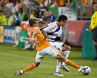 Houston Dynamo midfielder Stuart holden (22) stretches for the ball in front of FC Dallas defender Blake Wagner (19).  Houston Dynamo defeated FC Dallas 1-0 at Robertson Stadium in Houston, TX on May 9, 2009