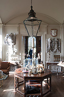 An elegant ante-room separating dining room and the library houses yet more curious artefacts