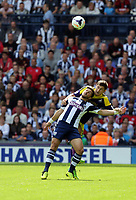 Pictured:  Ben Davies of Swansea heads the ball over Shane Long of West Brom. Sunday 01 September 2013<br /> Re: Barclay's Premier League, West Bromwich Albion v Swansea City FC at The Hawthorns, Birmingham, UK.