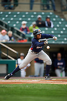 Toledo Mudhens shortstop Dixon Machado (28) lays down a bunt during a game against the Rochester Red Wings on May 12, 2015 at Frontier Field in Rochester, New York.  Toledo defeated Rochester 8-0.  (Mike Janes/Four Seam Images)