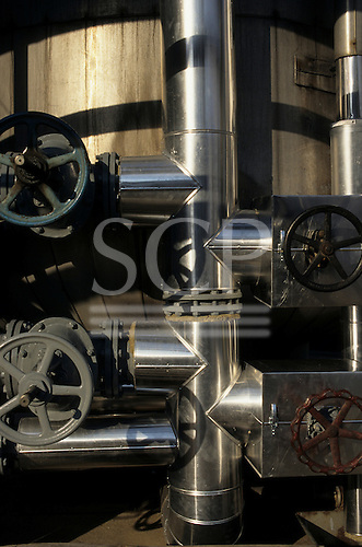 Debrecen, Hungary. Lagged pipes and valve wheels; TVK chemical processing plant.
