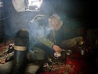 Ooroon Boi smokes opium 3 times a day, each session is about 1 hour..Opium users ins.Opium users inside Ooroon Boi's house, son of the Khan. Winter expedition through the Wakhan Corridor and into the Afghan Pamir mountains, to document the life of the Afghan Kyrgyz tribe. January/February 2008. Afghanistan
