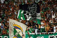 CALI -COLOMBIA-28-AGOSTO-2014. Seguidores del Deportivo Cali de Colombia muestran el apoyo a su equipo durante el partido contra de UTC Cajamarca del Peru durante las eliminatorias de la Copa Sudamericana jugado en el estadio Pascual Guerrero de la ciudad de  Cali . / Followers of Deportivo Cali of Colombia show support to their team during tha match against UTC Cajamarca Peru for qualifying of the Copa Sudamericana played in Pascual Guerrero stadium in Cali.  Photo: VizzorImage / Juan Carlos Quintero / Stringer