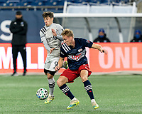 FOXBOROUGH, MA - NOVEMBER 20: Bojan #9 of Montreal Impact and Adam Buksa #9 of New England Revolution battle for the ball during the Audi 2020 MLS Cup Playoffs, Eastern Conference Play-In Round game between Montreal Impact and New England Revolution at Gillette Stadium on November 20, 2020 in Foxborough, Massachusetts.