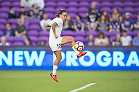 Orlando, FL - Saturday March 24, 2018: Utah Royals midfielder Taylor Lytle (12) takes a shot prior to a regular season National Women's Soccer League (NWSL) match between the Orlando Pride and the Utah Royals FC at Orlando City Stadium. The game ended in a 1-1 draw.