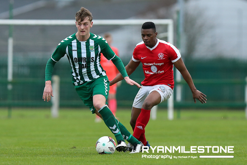 Shane Ryan of St Michael's in action against Tino Nzvaura of Newmarket Celtic during the FAI Junior Cup 6th Round game between St Michael's and Newmarket Celtic  on Sunday 13th January 2019 at Cooke Park, Tipperary Town, Co Tipperary. Mandatory Credit: Michael P Ryan.