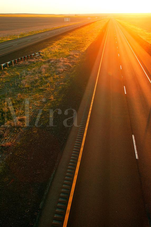 Trucks on Interstate 90 pass through farmland near Ritzville in Eastern Washington