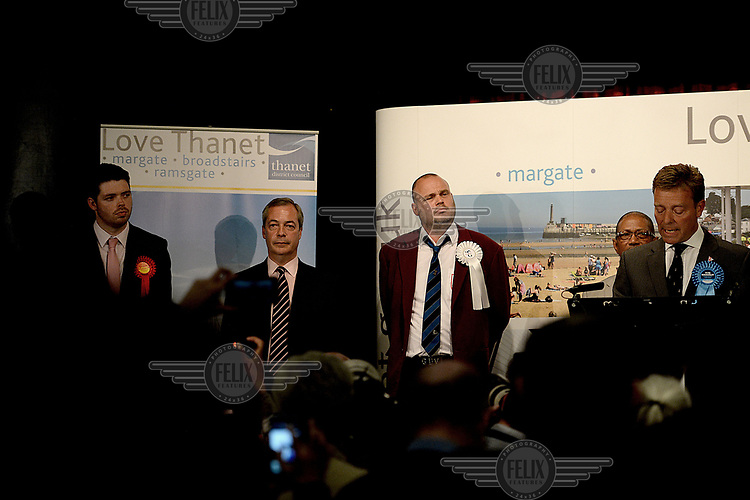 UKIP leader Nigel Farage loses the South Thanet election to Conservative candidate Craig Mackinlay on 8 May 2015. Pictured (l-r) are Labour Candidate Will Scobie, Nigel Farage, comedien Al Murray ('the Pub Landlord'), Independent candidate Dean McCastree and winning Conservative candidate Craig Mackinlay. Farage was booed and hissed by the audience as his result was read out.