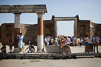 Tourists are seen in the forum on Friday, Sept. 18, 2015, in Pompeii, Italy. The city of Pompeii was destroyed when nearby Mount Vesuvius erupted on August 24, AD 79. The town and its residents were buried and forgotten until the ruins were discovered and eventually excavated hundreds of years later. The ruins are one of Italy's top tourist attractions today. (Photo by James Brosher)