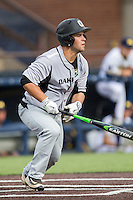 Oakland Golden Grizzlies outfielder Ryan Fitzgerald (9) heads to first base against the Michigan Wolverines on May 17, 2016 at Ray Fisher Stadium in Ann Arbor, Michigan. Oakland defeated Michigan 6-5 in 10 innings. (Andrew Woolley/Four Seam Images)