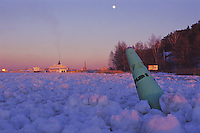 Ice packed channel at sunrise in the approaches to Turku harbour during full moon. -Finland