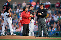 Rochester Red Wings athletic trainer Larry Bennese, first baseman Matt Hague (center), and umpire Chris Graham on the field as pitcher Stephen Gonsalves (23) gets ready to deliver a warmup pitch after being hit with a broken bat during a game against the Buffalo Bisons on August 25, 2017 at Frontier Field in Rochester, New York.  Buffalo defeated Rochester 2-1 in eleven innings.  (Mike Janes/Four Seam Images)