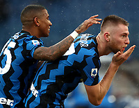 Football, Serie A: AS Roma -  FC Internazionale Milano, Olympic stadium, Rome, January 10, 2021. <br /> Inter's Milan Skriniar (r) celebrates after scoring with his teammate Ashley Young (l) during the Italian Serie A football match between Roma and Inter at Rome's Olympic stadium, on January 10, 2021.  <br /> UPDATE IMAGES PRESS/Isabella Bonotto