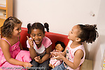 Preschool ages 3-5 three lively animated girls holding conversation in dressup area horizontal