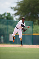 GCL Pirates third baseman Tilsaimy Melfor (12) throws to first base during a Gulf Coast League game against the GCL Twins on August 6, 2019 at Pirate City in Bradenton, Florida.  GCL Twins defeated the GCL Pirates 1-0 in the second game of a doubleheader.  (Mike Janes/Four Seam Images)
