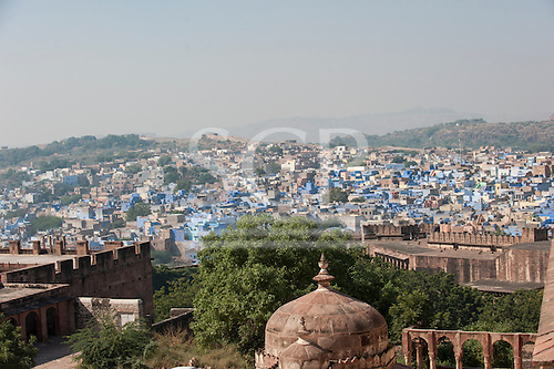Jodhpur, India. The Blue City. Sandstone battlements at the Mehrangarh fort and the blue-painted houses of the city below.