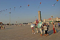 Tourists watch as kite vendors proudly fly their merchandise in Tiananmen Square in Beijing, China..18 Aug 2004