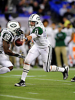 3 December 2009: New York Jets' quarterback Kellen Clemens makes a handoff to running back Thomas Jones during a game against the Buffalo Bills at the Rogers Centre in Toronto, Ontario, Canada. The Jets defeated the Bills 19-13. Mandatory Credit: Ed Wolfstein Photo
