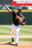 May 13, 2009:  Relief Pitcher Juan Morillo of the Rochester Red Wings, International League Class-AAA affiliate of the Minnesota Twins, delivers a pitch during a game at Frontier Field in Rochester, FL.  Photo by:  Mike Janes/Four Seam Images
