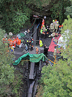 Pictured: Aerial view of rescuers outside Gleision Colliery. Friday 16 September 2011<br /> Re: It has been announced that the dead body of one of the miners has been found by emergency services trying to rescue four colliers that have been trapped at Tareni Gleision drift colliery at Cilybebyll, near Pontardawe, south Wales.<br /> The four men who are subject of the rescue operation have been named as Phillip Hill, aged 45, from Neath, Charles Bresnan, aged 62, from the Swansea Valley, David Powell, aged 50, from the Swansea Valley, and Garry Jenkins, aged 39, from the Swansea Valley.