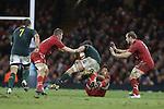 Wales number 8 tackles Springbok lock Eben Etzebeth<br /> 2013 Dove Men Series<br /> Wales v South Africa<br /> Millennium Stadium<br /> 09.11.13<br /> ©Steve Pope-Sportingwales
