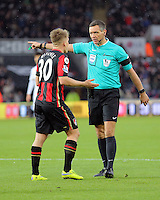 Matt Ritchie of Bournemouth argues with referee Andrew Marriner for awarding a penalty during the Barclays Premier League match between Swansea City and Bournemouth at the Liberty Stadium, Swansea on November 21 2015