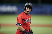 Heriberto Hernandez (11) of the Charleston RiverDogs reacts after working a walk during the game against the Augusta GreenJackets at Joseph P. Riley, Jr. Park on June 25, 2021 in Charleston, South Carolina. (Brian Westerholt/Four Seam Images)