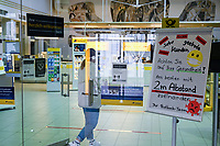 GERMANY, Hamburg, Corona Virus, COVID-19 , post office with information sign to hold distance for customer to avoid infection