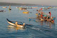 Jimbaran, Bali, Indonesia.  Fishermen Heading out to Sea in the  Early Morning.  Bukit Peninsula in the Background.