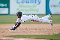 Yordys Valdes (7) of the Lynchburg Hillcats dives head first into third base during the game against the Myrtle Beach Pelicans at Bank of the James Stadium on May 23, 2021 in Lynchburg, Virginia. (Brian Westerholt/Four Seam Images)
