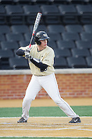 Garrett Kelly (28) of the Wake Forest Demon Deacons at bat against the Marshall Thundering Herd at Wake Forest Baseball Park on February 17, 2014 in Winston-Salem, North Carolina.  The Demon Deacons defeated the Thundering Herd 4-3.  (Brian Westerholt/Four Seam Images)