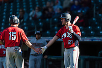Gonzaga Bulldogs right fielder Troy Johnston (21) congratulates Ernie Yake (15) after scoring a run during a game against the Oregon State Beavers on February 16, 2019 at Surprise Stadium in Surprise, Arizona. Oregon State defeated Gonzaga 9-3. (Zachary Lucy/Four Seam Images)