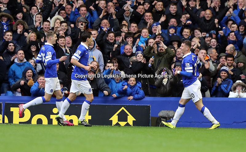 Pictured: Ross Barkley of Everton (R) is celebrating his goal with team mates. Saturday 22 March 2014<br /> Re: Barclay's Premier League, Everton v Swansea City FC at Goodison Park, Liverpool, UK.