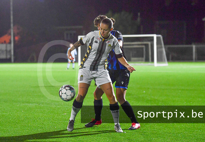 midfielder Alysson Duterne of Sporting Charleroi pictured defending the ball from Brugge's Isabelle Iliano  during a female soccer game between Sporting Charleroi and Club Brugge YLA on the fourth matchday of the 2020 - 2021 season of Belgian Scooore Womens Super League , friday 9 nd of October 2020  in Marcinelle , Belgium . PHOTO SPORTPIX.BE | SPP | DAVID CATRY