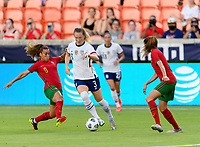 HOUSTON, TX - JUNE 10: Andreia Norton #8 of Portugal attempts to strip the ball from Samantha Mewis #3 of the United States during a game between Portugal and USWNT at BBVA Stadium on June 10, 2021 in Houston, Texas.