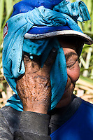 Portrait of tired elderly sugarcane cutter, many women and aged people work in this exhausting job in Brazil. Ester ethanol and sugar plant, Cosmopolis city, Sao Paulo State, Brazil.