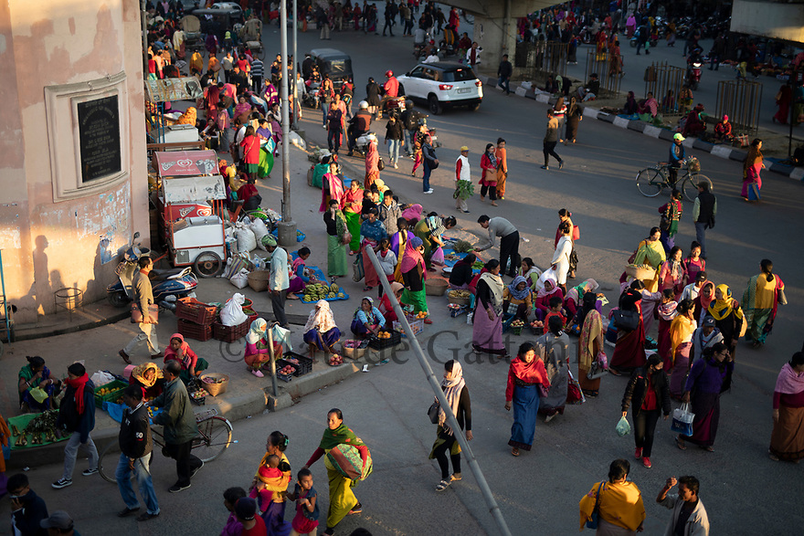 India - Manipur - Imphal - An overview of the buzzling streets surrounding the market right before the sunset. The Ima Market is located right in the center of Imphal and constitutes a crossroad of the city.
