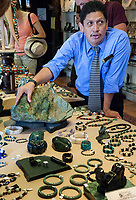 Antigua, Guatemala.  Salesman Showing Jade Jewelry Produced by his Workshop.