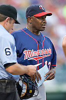 Minnesota Twins coach Jerry White #13 delivers the lineup card before the Major League Baseball game against the Texas Rangers at the Rangers Ballpark in Arlington, Texas on July 27, 2011. Minnesota defeated Texas 7-2.  (Andrew Woolley/Four Seam Images)