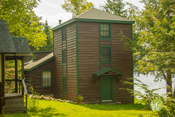 Three story tower attached to historic log cabin. Camp Allagash, Moosehead Lake, ME.