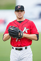Jacob Morris (24) of the Kannapolis Intimidators warms up in the outfield prior to the game against the Greenville Drive at CMC-Northeast Stadium on April 6, 2014 in Kannapolis, North Carolina.  The Intimidators defeated the Drive 8-5.  (Brian Westerholt/Four Seam Images)