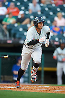 Norfolk Tides catcher Francisco Pena (29) runs to first during a game against the Buffalo Bisons on July 18, 2016 at Coca-Cola Field in Buffalo, New York.  Norfolk defeated Buffalo 11-8.  (Mike Janes/Four Seam Images)